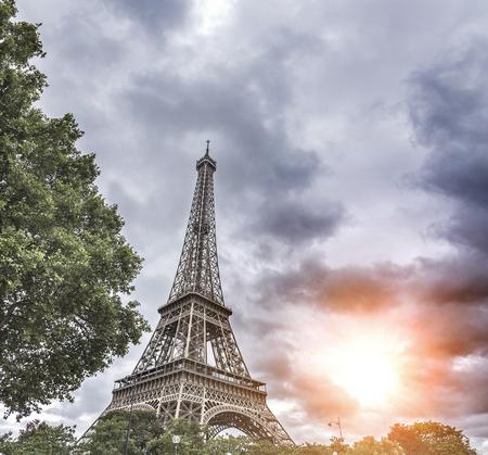 eiffel: Dramatic cloudy sky above Eiffel Tower in Paris, France. Stock Photo