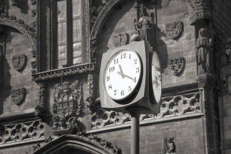 gothic architecture: Street clock on a background of the Gothic architecture. Stock Photo