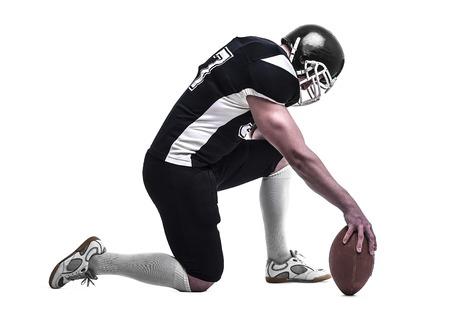jugador de futbol: American football player  isolated on white background Foto de archivo