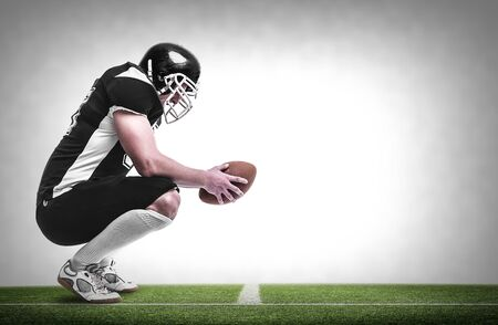 player: American football player on the football pitch. Stock Photo