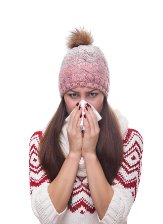 tonsillitis: Runny nose of the girl in winter clothes. Isolated on white.