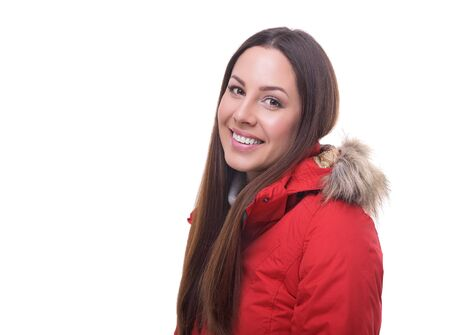 sexy young woman: Beautiful woman in winter red jacket. Isolated on white background.