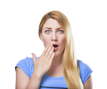 Shocked blonde lady with her mouth opened, isolated on white.