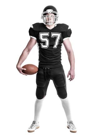 uniforme de futbol: Jugador de fútbol americano aisladas sobre fondo blanco.
