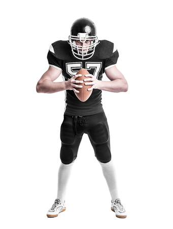crouches: American football player  isolated on white background.