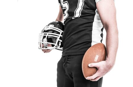 crouches: American football player isolated on white background. Stock Photo