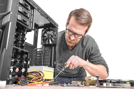 pc repair: Computer repair. Computer technician working on a personal computer.