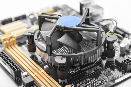pci card: Computer motherboard with CPU cooler on white background. Stock Photo