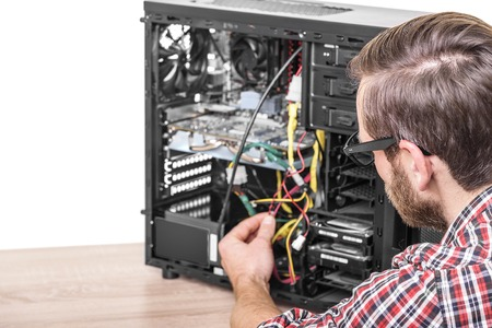 computer engineer: Computer engineer repairs or mount the computer. Stock Photo