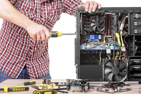 disassemble: Technician repair assembles computer. Isolated on a white background.