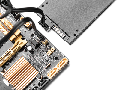SSD hard drive with cable connected to motherboard.  Concept of cloud drive, or communications.
