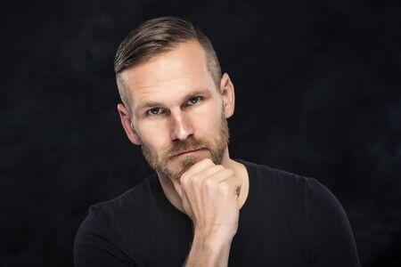 natural face: Portrait of an handsome gent man on dark background.