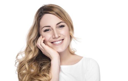 Portrait of smiling woman blond isolated on white. Archivio Fotografico