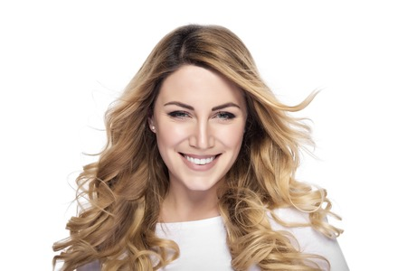 Attractive blonde smiling woman portrait over white background