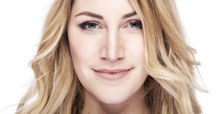 face close up: Beautiful blond woman face portrait close up.