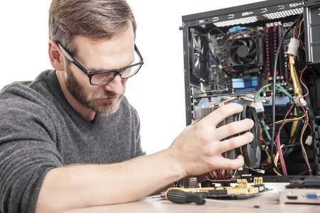 Computer repair. Technician installs accessories of computer.
