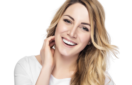 beautycare: Beautiful young blond smiling woman with clean face.
