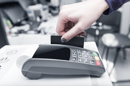 cardreader: Payment card in a bank terminal. The concept of of electronic payment.