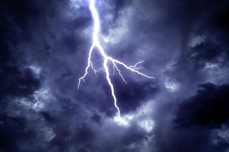lightning strike: Lightning strike on the dark cloudy sky.