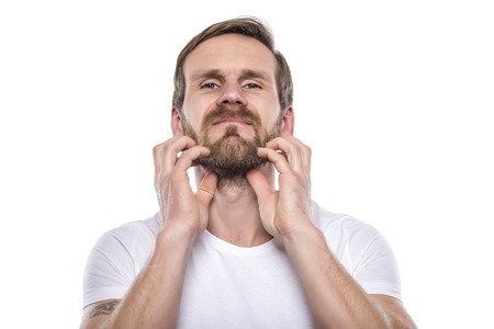 nonverbal: Adult male scratching beard isolated on white. Stock Photo