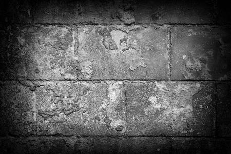 edges: Grey brick wall abstract background. Dark edges. Stock Photo