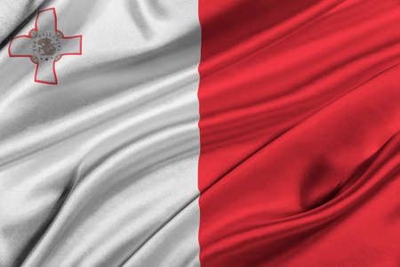 solemn: Flag of Malta waving in the wind.