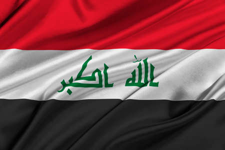 solemn: Flag of Iraq waving in the wind. Stock Photo