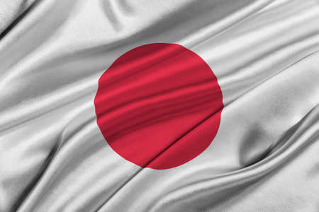 solemn: Flag of Japan waving in the wind.
