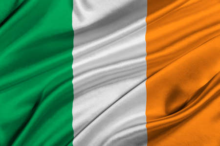 solemn: Flag of Ireland waving in the wind.
