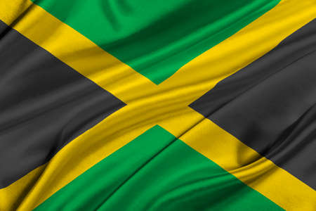 solemn: Flag of Jamaica waving in the wind.