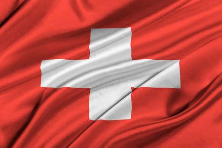 solemn: Flag of Switzerland waving in the wind.