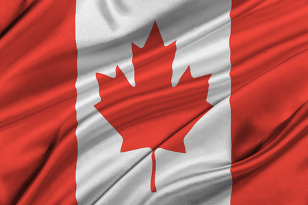 solemn: Flag of Canada waving in the wind.