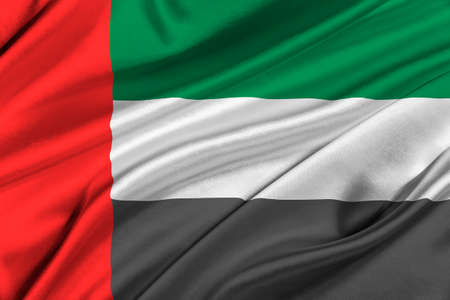 solemn: Flag of United Arab Emirates waving in the wind.