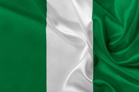 solemn: Flag of Nigeria waving in the wind.