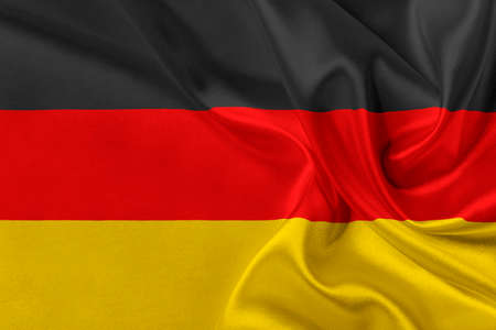 solemn: Flag of Germany waving in the wind.