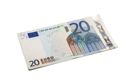 pay cuts: Twenty euro banknote isolated on white background with clipping path.
