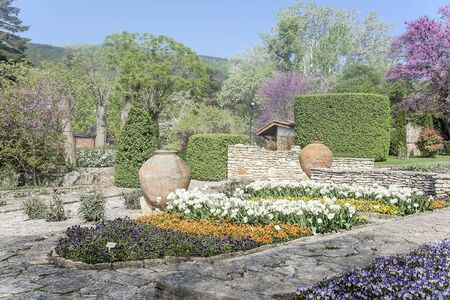balchik: Botanical garden with stone paths at dawn.