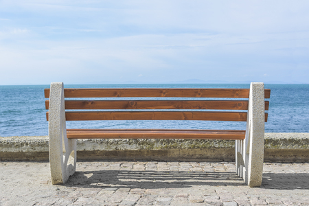 empty bench: Empty bench on the background of the sea. Stock Photo