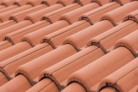 roof texture: Close-up of roof tiles. Red roof texture.