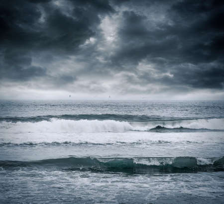 stormy: Dark stormy sky and stormy sea waves.