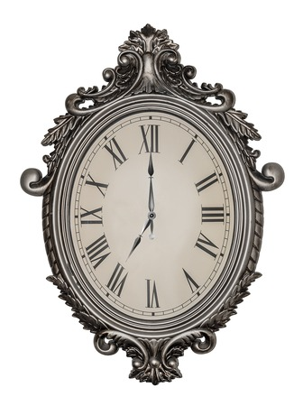 seven o'clock: Seven oclock. Antique wall clock isolated on white background.