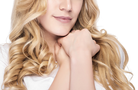 hair part: Part of face. Beautiful woman with blond hair. Fashion model posing at studio. Stock Photo