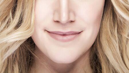face close up: Part of face. Beautiful blond woman face portrait close up. Stock Photo