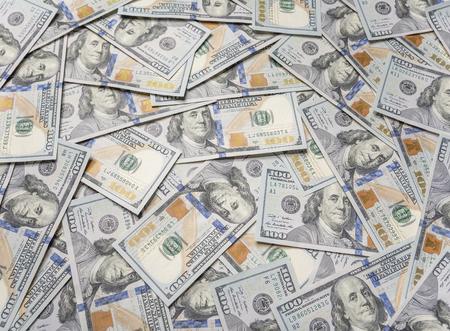 One hundred dollars background. Background paved with hundred dollar bills.