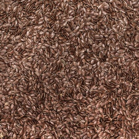 genetically modified crops: Flax seed cereal and grain texture as a symbol of healthy eating Stock Photo