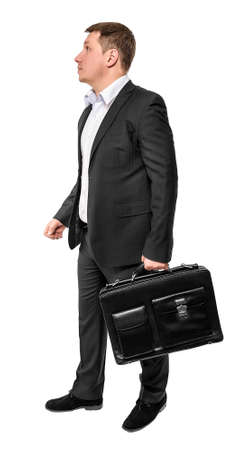 brief: Going business man holding brief case over white