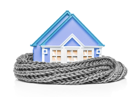 House wrapped in a scarf isolated on white. Conceptual image.