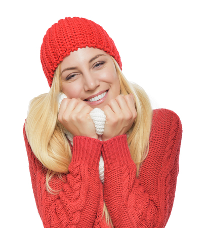 Lovely beautiful blonde in red winter clothes luxuriates wrapped in a scarf. Isolated on white background