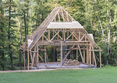laths: Building a new wooden house in the forest. Stock Photo
