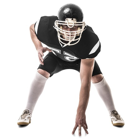 crouches: American football player  isolated on white background Stock Photo